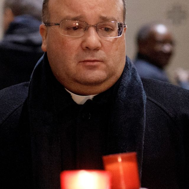 Msgr. Charles Scicluna, the Vatican's chief prosecutor of clerical sexual abuse, attends a Feb. 7 penitential vigil at St. Ignatius Church in Rome to show contrition for clerical sexual abuse.