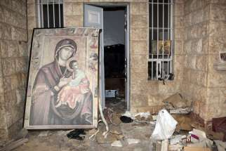 A painting of Mary and the Christ Child is is seen in 2014 at the damaged St. Thecla Orthodox monastery in the predominantly Christian town of Maaloula, Syria. Russia's Catholic Church has launched a joint project with Russian Orthodox leaders to rebuild churches and monasteries destroyed during the war in Syria.