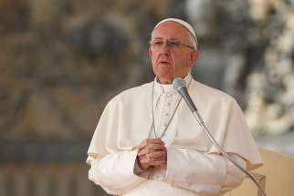Pope Francis leads his general audience in St. Peter's Square at the Vatican Oct. 19.