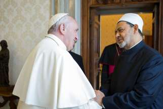 Pope Francis greets Ahmad el-Tayeb, grand imam of Egypt's al-Azhar mosque and university, during a private meeting at the Vatican May 23.