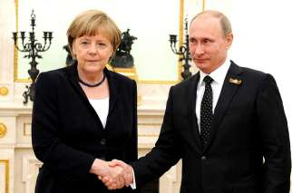 German Chancellor Angela Merkel shakes hands with Russian President Vladimir Putin in May 2015. Cardinal Pietro Parolin says peace and end to violent conflicts should be placed above any national interests when it comes to relationship between Western countries and Russia.