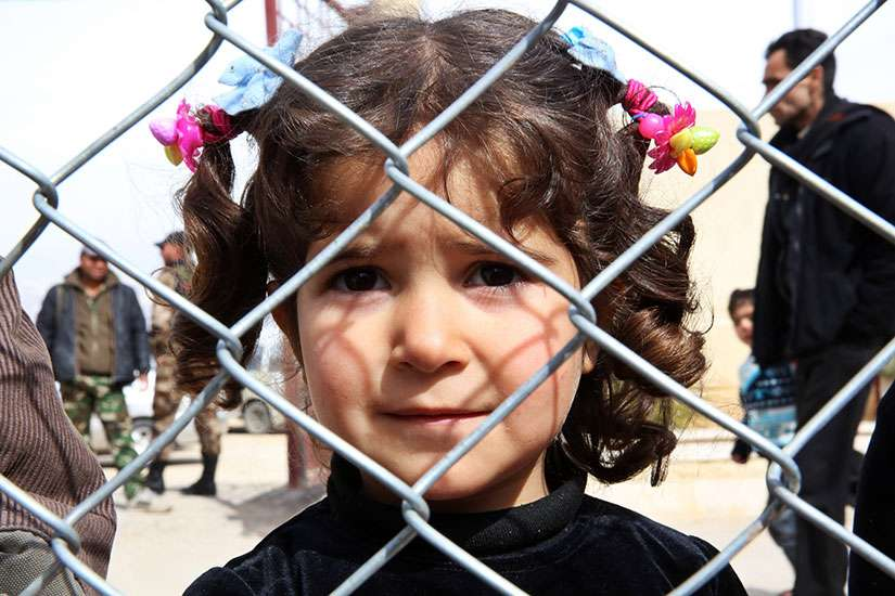 A displaced Syrian girl finds temporary shelter at a school in Damascus, Syria, Feb. 23.