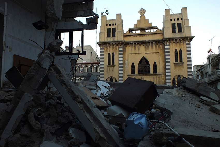 "A damaged Syriac Catholic Church is pictured in Homs, Syria. Syriac Catholic bishops from around the world, meeting in Lebanon for their annual synod, lamented the plight of their ""tormented and persecuted"" faithful."