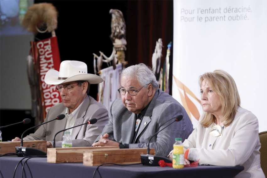 Chief Wilton Littlechild, Justice Murray Sinclair and Marie Wilson, members of the Truth and Reconciliation Commission, take part in a 2015 press conference in Ottawa.