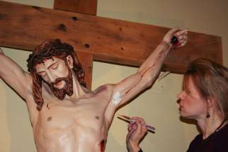 Pauline Winogron working on the restoration of a crucifix.