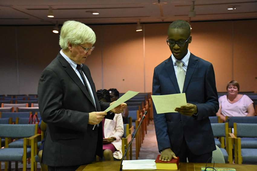 Joel Ndongmi is sworn in by Paul Matthews, General Legal Counsel for TCDSB, at the Catholic Education Centre on Sept. 7.