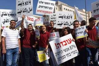 Israeli Arab Christians demonstrate outside Israeli Prime Minister Benjamin Netanyahu's office in Jerusalem Sept. 6, to protest government budget cuts to their schools.