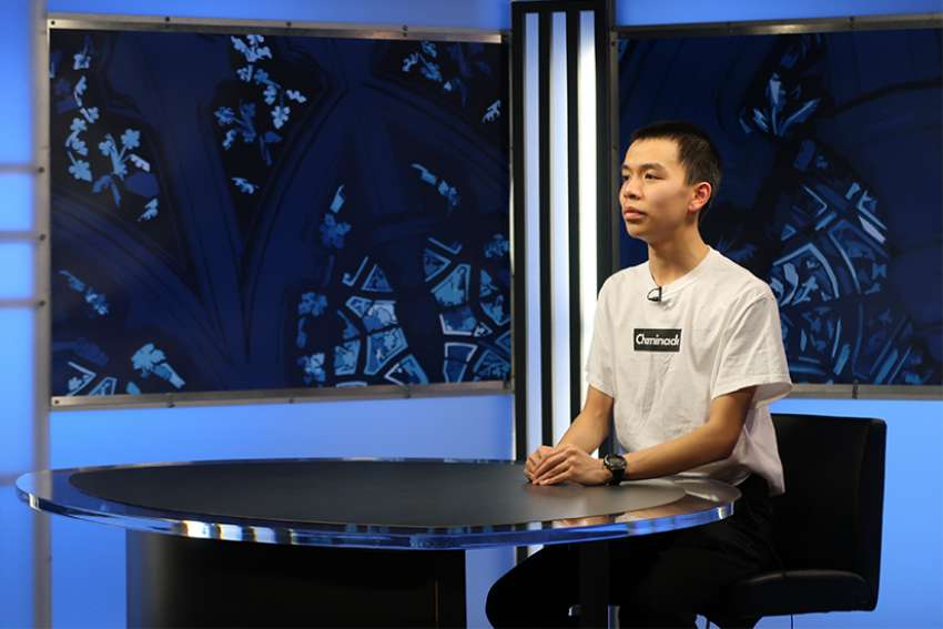 Vincent Pham goes on camera at the Salt + Light studios during the Youth Speak News retreat May 2018.