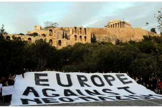 People demonstrate silently in this 2012 file photo of a protest in Athens, Greece, against a rising surge of racism, anti-Semitism and neo-Nazism in Europe.