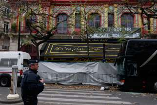 A policeman stands guard outside the Bataclan music hall in Paris Nov. 16. The Islamic State claimed responsibility for a Nov. 13 attack on the hall.