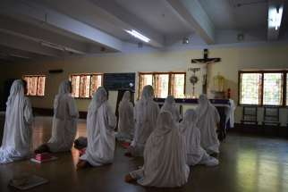 Nuns pray in Kolkata, India, Aug. 4. Although the Sept. 4 canonization of Blessed Teresa is in Rome, special festivities to honor her will continue in Kolkata until Christmas.