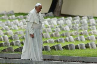 Pope Francis walks through the Austro-Hungarian cemetery for soldiers of World War I in Fogliano di Redipuglia, Italy, Sept. 13. The pope prayed for the fallen of all wars and also celebrated an outdoor Mass in front of the nearby Redipuglia war memorial , which honors the 100,000 Italian soldiers who died during World War I.