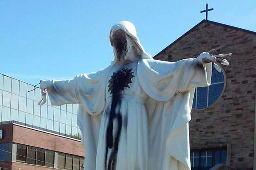 Police are investigating the desecration of the Sacred Heart of Jesus statue outside Mississauga, Ont.'s St. Catherine of Siena Church as a hate crime.