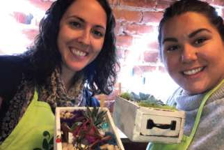 Vanessa Santilli-Raimondo, left, and Plant Nite friend Sarah Avarell with their new creations.