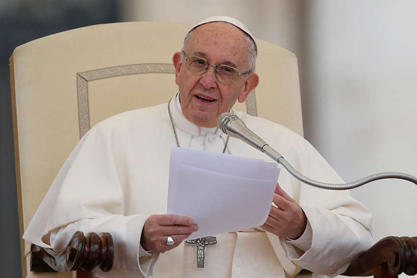 Pope Francis speaks during his general audience in St. Peter's Square at the Vatican Nov. 15.