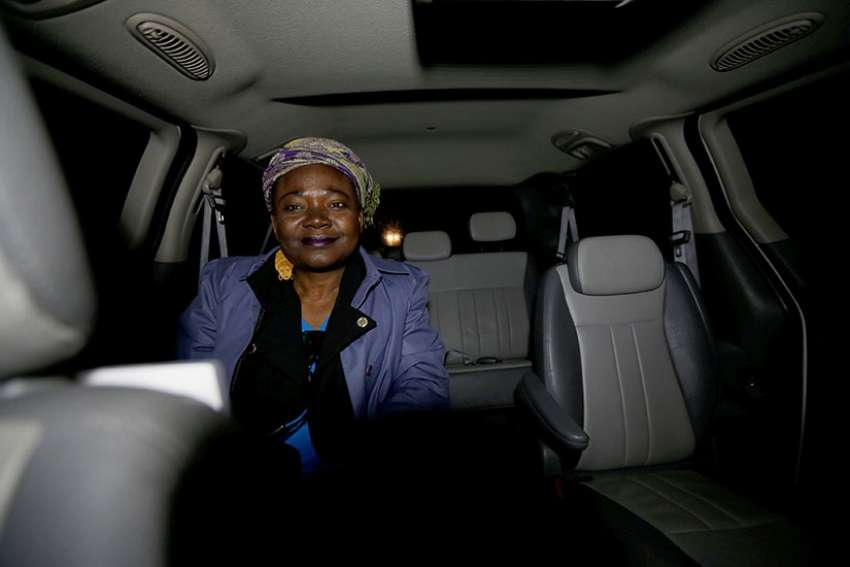 A Haitian woman, who gave her name as Cilotte, takes a taxi to the U.S.-Canada border April 26 from Champlain, N.Y.