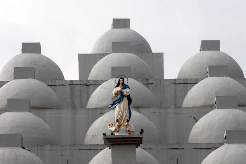 A statue of Mary is seen in 2017 atop the Cathedral of Managua in Nicaragua. On Nov. 18, 2019, a pro-government mob entered the cathedral, damaging property, attacking hunger strikers inside the building and jostling a priest and nun, the Archdiocese of Managua said.