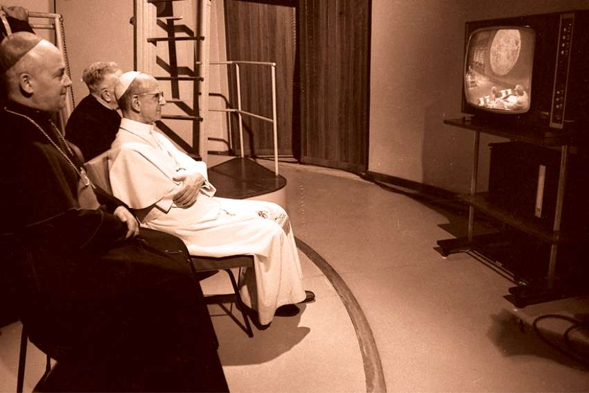 Pope Paul VI watches the moon landing on television at the Vatican Observatory in Castel Gandolfo, Italy.