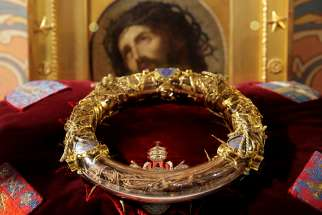 A reliquary containing what tradition holds is Jesus' crown of thorns is displayed during a ceremony at Notre Dame Cathedral in Paris March 21, 2014. A major blaze engulfed the iconic cathedral April 15, 2019, sending pillars of flame and billowing smoke over the center of the French capital.
