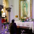 A Mass-goer prays in the Guadalupe chapel inside St. Ignatius Cathedral in Shanghai in this 2007 file photo. The image of Our Lady of Guadalupe -- most popular in Mexico and the Americas -- has been well-received by Catholics around the globe.