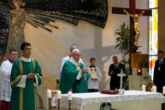 Pope Francis uses incense as he celebrates Mass at the Church of the Immaculate Conception in Baku, Azerbaijan, Oct. 2.