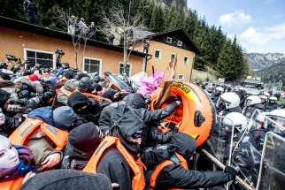 Austrian riot police clash with protesters April 24 during a rally against the government's planned re-introduction of border controls at Brenner Pass near Italy.