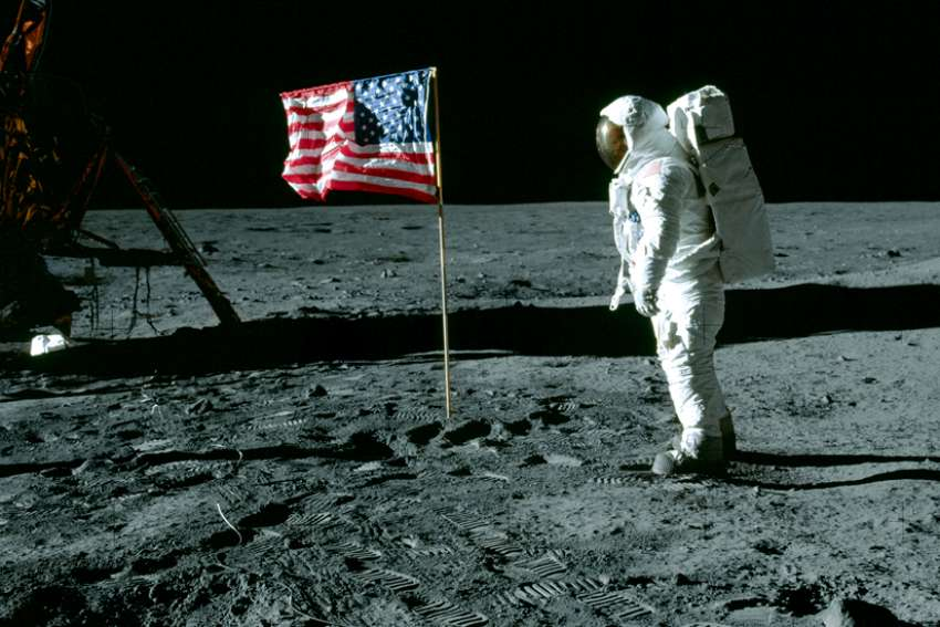 "Astronaut Edwin ""Buzz"" Aldrin poses beside U.S. flag during the Apollo 11 mission on the moon July 20, 1969."