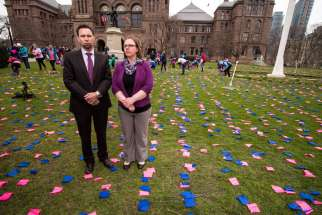 We Need A Law campaign director Mike Schouten and media relations assistant Niki Pennings on the front lawn of Queen's Park, where the campaign had arranged a display of 100,000 pink and blue flags to represent 100,000 abortions performed in Canada each year. The We Need A Law parent organization, ARPA Canada, is going to court to challenge an Ontario law that limits access to abortion information.