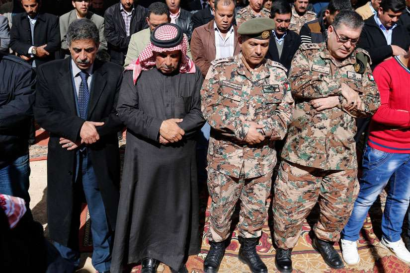 Saif al-Kasasbeh, second from left, father of First Lt. Muath al-Kasasbeh, Jordanian pilot, prays in Jordan Feb. 4 with other mourners during an event commemorating the Islamic State murder of the pilot.
