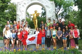 Students pose in front of Mozart's statue in Vienna during last year's summer trip.