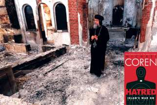 A Coptic Orthodox bishop surveys the damaged evangelical church in Minya, Egypt, Aug. 26, 2013. Attacks on Christian properties by Muslim Brotherhood and other groups supportive of ousted leader Mohammed Morsi are not uncommon in Egypt.