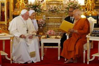 Pope Francis visits with Somdej Phra Maha Muneewong, supreme patriarch of Buddhists, at the Wat Ratchabophit temple in Bangkok Nov. 21, 2019.