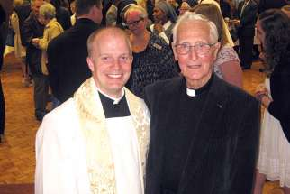 Fr. David Reitzel, left, is the latest in the Reitzel family to join the priesthood. He was ordained May 7 in Hamilton, Ont. He's seen here with his uncle, Fr. Frank Reitzel. Two other Reitzel's are also priests and another will be ordained next year.