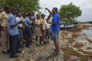 Marine biologist Jean Wiener meets with high school students in late January to discuss their threatened natural resources along the costal area of Caracol, Haiti. Few papal encyclicals have been as eagerly awaited as Pope Francis' upcoming statement on the environment.