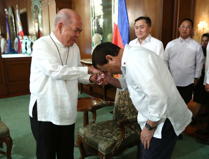 Philippine President Rodrigo Duterte, right, greets Archbishop Romulo Valles of Davao, president of the Catholic Bishops' Conference of the Philippines, before a meeting inside the presidential palace in Manila.
