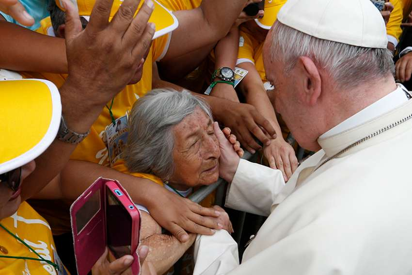"Pope Francis greets a blind woman who is 99 years old along the parade route in Trujillo, Peru, Jan. 20. At the end of their plenary meeting March 6-9 at the Vatican, members of the Pontifical Commission for Latin America proposed that the church hold a Synod of Bishops ""on the theme of the woman in the life and mission of the church."""