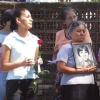People hold photos of Maryknoll Sister Maura Clarke, Ursuline Sister Dorothy Kazel and Maryknoll Sister Ita Ford during a prayer service in 2007 at a shrine at the site where the three missionaries were murdered in San Salvador, El Salvador. Dec. 2 marked the 30th anniversary of the martyrdom of the three nuns and lay missionary Jean Donovan, who were kidnapped, raped and killed in El Salvador. (CNS photo/Courtesy of Maryknoll Sister Margaret Dillon)
