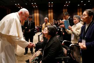 "Pope Francis greets people as he arrives for a meeting with victims of the 2011 ""triple disaster"" (earthquake, tsunami and nuclear power plant meltdown) at Bellesalle Hanzomon, Tokyo, Japan, Nov. 25, 2019."