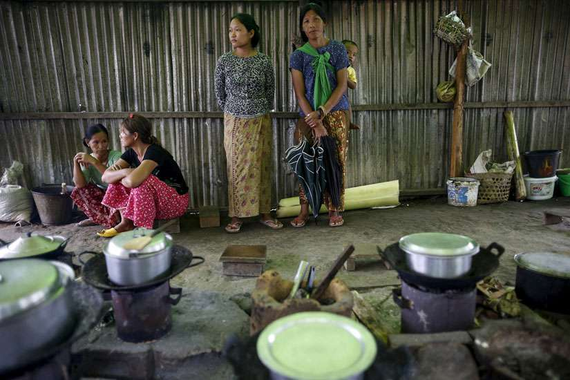 Ethnic Kachin refugees are seen inside a shared kitchen at a camp in Myitkyina, Myanmar, July 30.