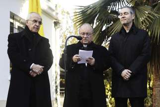 Archbishop Charles Scicluna of Malta speaks during a press conference accompanied in Santiago, Chile, June 12. He is accompanied by Father Jordi Bertomeu Farnos, right, an official of the Vatican's doctrinal congregation.