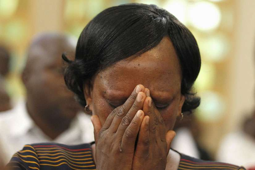A woman prays during a special Easter Mass at Holy Family Basilica in Nairobi for victims of the massacre at Garissa University College. Al-Shabaab militants raided the campus April 2, leaving 148 dead.