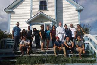 Bishop Mark Hagemoen with his crew of helpers, including his OCY visitors from the south.