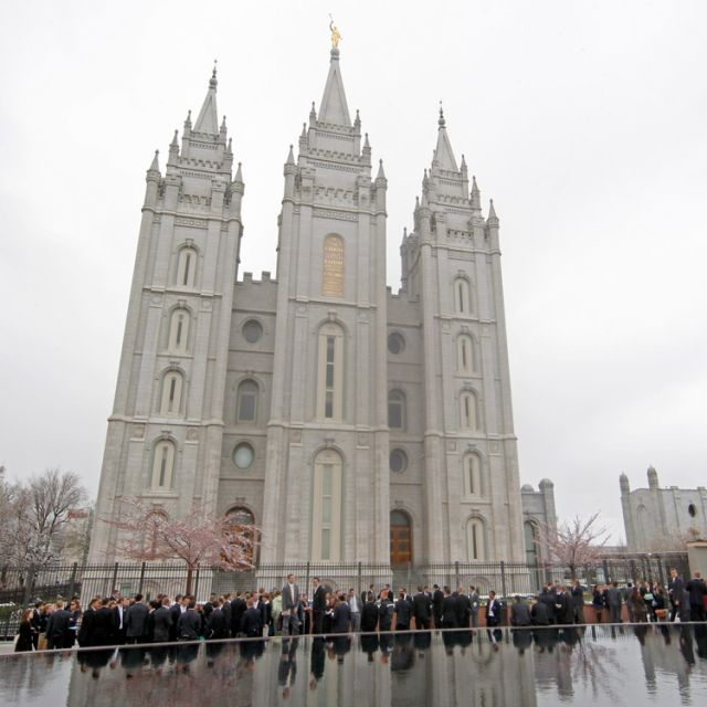 Members of the Church of Jesus Christ of Latter-day Saints gather around the Mormon Salt Lake Temple in early April 2011 in Salt Lake City. According to a new Pew Forum poll, most Mormons feel their religion is not well understood but say people are becoming more tolerant of their beliefs.