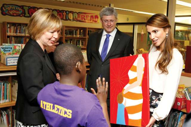 Prime Minister Stephen Harper and Queen Rania Al Abdullah of Jordan meet with students at Toronto's Davisville Public School and are presented with a painting by vice principal Lara Schneider and student Joseph Awuah.