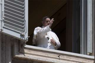 Pope Francis gives his blessing from the window of the library in the Apostolic Palace at the Vatican May 3, 2020.