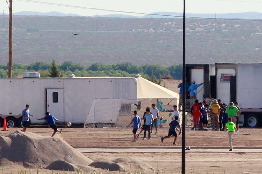 Children of detained migrants play soccer at a tent encampment near Tornillo, Texas, June 18. Image taken from Guadelupe, Mexico.