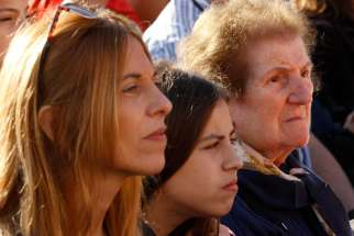 Family members from different generations attend an encounter and Mass for the elderly led by Pope Francis in St. Peter's Square at the Vatican in this Sept. 28, 2014, file photo. The pope will highlight the role of memory and storytelling across generations in his message for World Communications Day 2020.