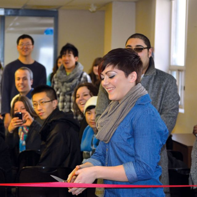 As representatives from the campus' faith-based groups look on in excitement, Ryerson Students' Union vice-president of education Melissa Palermo cuts though the red ribbon with gold scissors officially launching the school's first official multifaith room.