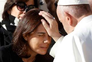 Pope Francis blesses a woman during his general audience in St. Peter's Square at the Vatican Nov. 21.