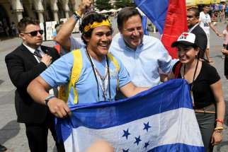 Panamanian President Juan Carlos Varela poses with pilgrims July 31 during World Youth Day at the main square in Krakow, Poland. Pope Francis announced that the next World Youth Day will take place in Panama in 2019.